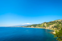 Taormina Ocean view with Etna in the Background. City of Taormina in Sicily with vulcano Etna in background stock images