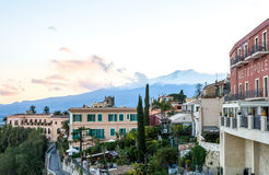 Taormina Ocean view with Etna in the Background. City of Taormina in Sicily with vulcano Etna in background royalty free stock photo