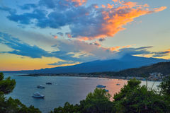 Taormina's Giardini-Naxos bay with the sea and the Etna volcano and Catania in the back in Sicily, Italy Stock Images