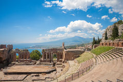 Taormina's theater. Greek theater in Taormina with the Etna volcano in the back in Sicily, Italy Royalty Free Stock Photo