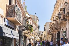 Taormina, Sicily – august 06, 2018: people walk on the historical street of the town.  stock photography