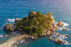 Taormina, Sicily - Beautiful landscape view of Isola Bella, the small Sicilian island of the mediterranean with beach. And turquoise sea water royalty free stock image