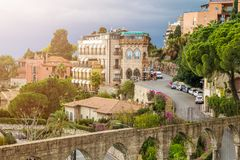 Taormina, Sicily - Beautiful view of the famous hilltop town of Taormina. With streets, trees and sunshine stock photography