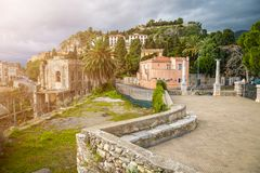 Taormina, Sicily - Beautiful view of the famous hilltop town of Taormina. With palm tree and sunshine stock photography