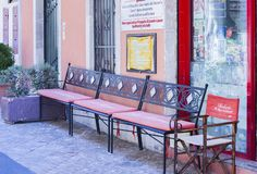 Taormina, Sicily, Italy – august 06 2018: iron benches in front of the famous pastry shop, bakery Roberto `Il mago dei cannoli` stock images