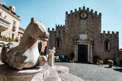 TAORMINA, SICILY / ITALY - OCTOBER 1, 2018: Cathedral of Taormina city and fountain of Piazza Duomo royalty free stock photo
