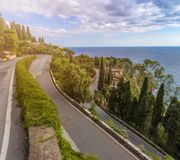 Taormina, Sicily - The streets of the famous hilltop town of Taormina with palm tree, mediterranean sea Royalty Free Stock Photography