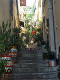 Taormina Side street Steps with Ceramic Pots in Sicily stock photo