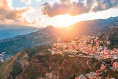 Taormina is a town on the island of Sicily, Italy. Aerial View from above in the evening to temper at the foot of the mountains.  royalty free stock photography