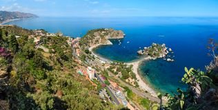 Taormina view from up, Sicily. Beautiful Taormina panoramic view from up Stairs to Taormina, Sicily, Italy. Sicilian seascape with coast, beaches and island stock photo