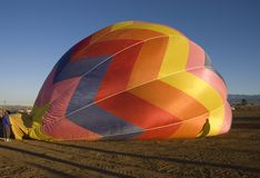 Taos balloon festival. One of the many balloons at the Taos balloon festival being inflated at dawn Stock Photography