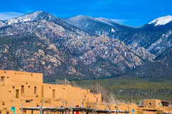 Taos New Mexico Sangre de cristo Mountains Ancient History. Taos Square and historic adobe stucco houses. Taos Cemetery Filled with Crosses Ancient Historic stock photo