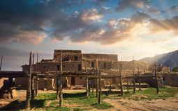 Free Taos Pueblo Illuminated By The Morning Sun Over The Sangre De Cristo Mountains In New Mexico Stock Photography - 167810112