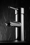 Tap. A luxury tap on blur black stone background Stock Photos