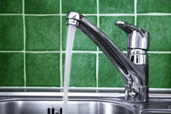 Tap. Kitchen water tap and green tiles Stock Image