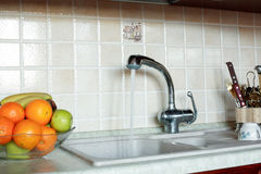 Tap. Fresh Vegetables, Fruits and other foodstuffs. Shot in a interior Stock Image