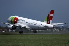 TAP Air Portugal plane taking off from runway stock photos