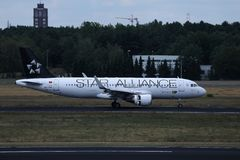 Star Alliance TAP Air Portugal plane doing taxi on runway royalty free stock image