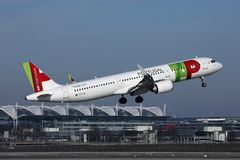 TAP Air Portugal plane flying to exotic destinations royalty free stock image