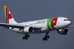 TAP Air Portugal plane flying up in the sky stock photo