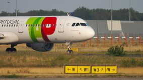 TAP Airbus A321 before departure. FRANKFURT AM MAIN, GERMANY - JULY 18, 2017: TAP Air Portugal Airbus A321 CS-TJF turn runway before taking off at runway18 stock footage
