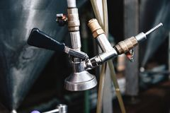 Tap of brewing equipment. Tap of beer giving. Beer production. Industrial equipment. Process of beer manufacturing Royalty Free Stock Photography