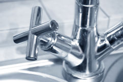 Tap conceptual image. Approximation of tap in kitchen Royalty Free Stock Photos