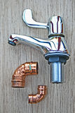 Tap and copper pipe fittings. Royalty Free Stock Image