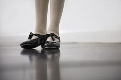 Tap Dance Class. Young dancer in tap shoes... low angle shot of just feet and legs Royalty Free Stock Photo