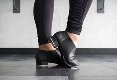 Tap dancer at the barre in dig. Close up of the feet of a Tap dancer in dance class at the barre in dig Stock Photos