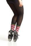 Tap Dancer's Feet. Closeup of tap dancer's feet in studio on white background wearing funny socks stock photo