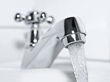 Tap and drinking water Royalty Free Stock Photos