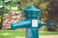 A tap with drinking water outdoors. Public water source. Stock Photo