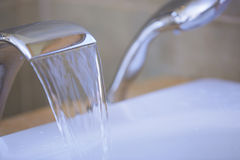 Tap with flowing water Stock Image
