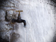 Tap on frozen wall royalty free stock images