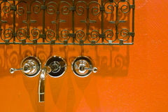Tap and grates on orange background Royalty Free Stock Photography