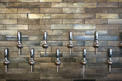 Tap Handles at Taphouse. Taphouse in Portland Oregon with multiple tap handles for craft beer and wine Stock Image