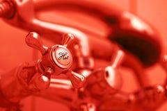 Tap of hot water. Fragment of water mixer in bathroom Stock Photo