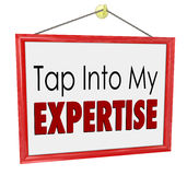 Tap Into My Expertise Store Sign Consultant Business Service. Tap Into My Expertise words on a hanging store sign advertising your unique or special skills or Stock Photos
