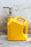 Tap and oil container Royalty Free Stock Photos