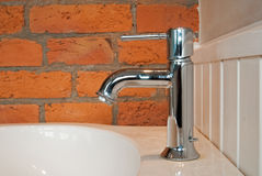 The tap with the old brick wall Stock Image