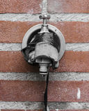 Tap. An outside tap on the wall Royalty Free Stock Image