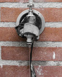 Tap. An outside tap on the wall Stock Image