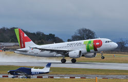 TAP Portugal Airbus A319. Taking off from Manchester Airport royalty free stock images