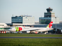TAP Portugal Airbus A321 taxiing at Prague Airport. PRAGUE, CZECH REPUBLIC - CIRCA APRIL 2015: TAP Portugal Airbus A321 taxiing at Vaclav Havel Airport Prague royalty free stock photo