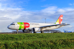TAP Portugal Airbus A320. Airbus A320 of TAP Portugal (Transportes Aéreos Portugueses) taxiing royalty free stock images