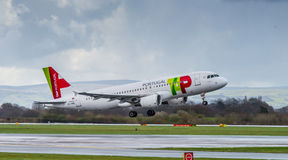 TAP Portugal Airways Airbus A320. Taking off from Manchester Airport stock images