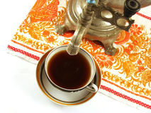 Tap samovar over a cup of tea Stock Image
