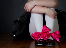Tap shoes on a little girls feet. Dark background room for copy space Stock Photo
