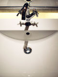 Tap and sink basin Royalty Free Stock Images
